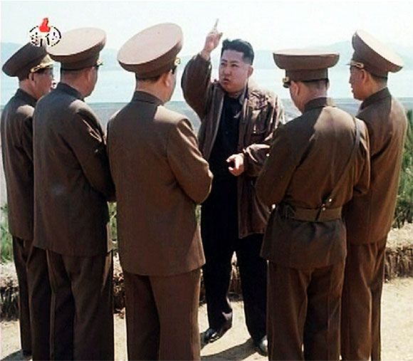 New leader of North Korea Kim Jong-un speaks while surrounded by soldiers in this undated still image taken from video