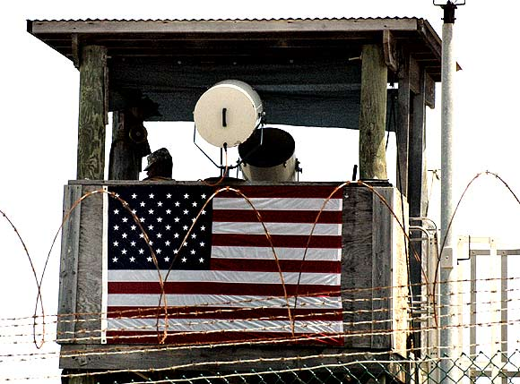 A guard looks from a tower above the Camp 4 detention facility for terrorism suspects at the US naval base at Guantanamo Bay
