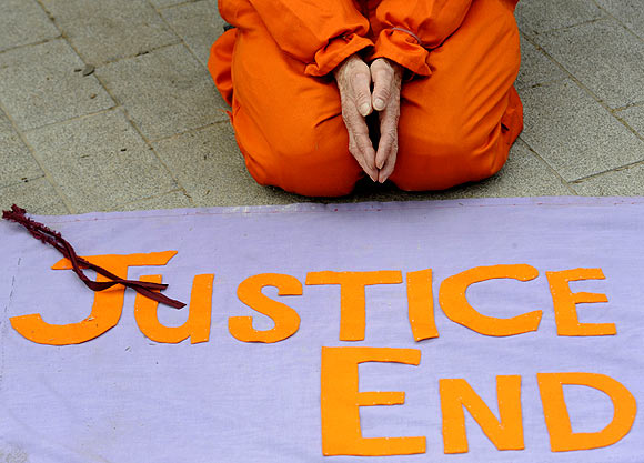 A demonstrator protests outside the US embassy in London for the release from the US prison in Guantanamo Bay in Cuba, of British detainee Binyam Mohamed