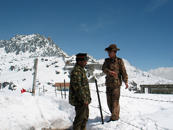 An Indian Army officer with a Chinese soldier at the 4,310 metre high Nathu-la pass on the country's northeastern border with China