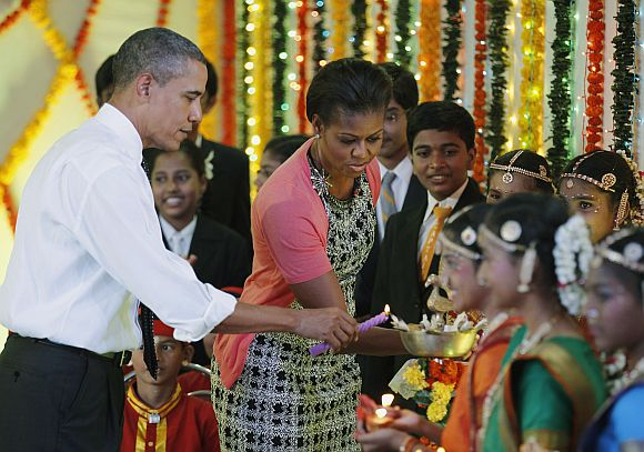 US President Barack Obama and first lady Michelle Obama light Diwali candles at Holy Name High School in Mumbai