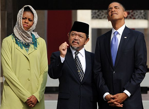 Barack and Michelle Obama are led on a tour by Grand Imam Ali Mustafa Yaqub at the Istiqlal Mosque in Jakarta