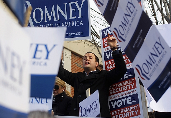 A supporter of Romney chants outside a polling station in Manchester