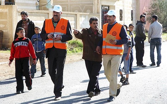 Members from Arab League observers delegation visit al-Msefra town near Deraa, southern Syria