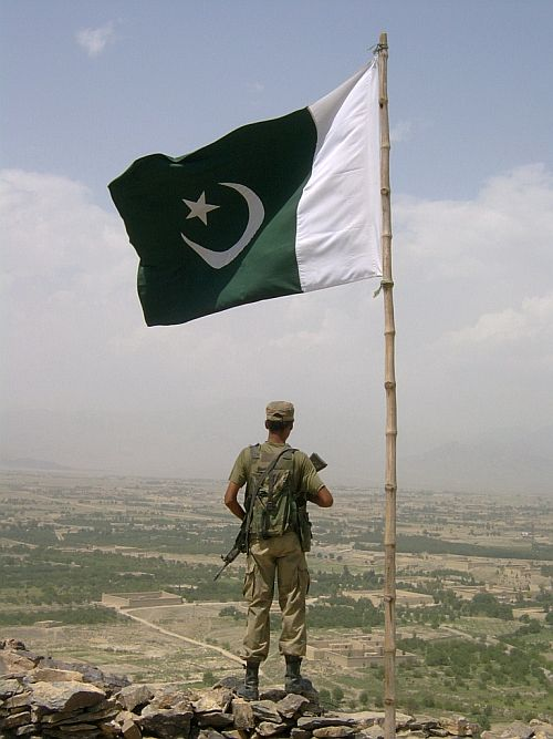 A Pakistan soldier stands guard at a checkpost