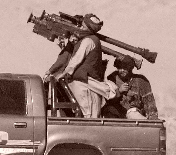 File picture of Taliban soldiers with an American Stinger missile launcher