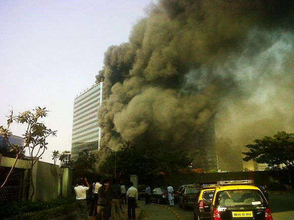 Smoke billows out of The Capital Tower in Mumbai's BKC after its first and second floors were engulfed in fire