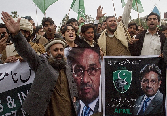 Supporters of Musharraf's party All Pakistan Muslim League chant slogans during a rally to support Musharraf in Islamabad