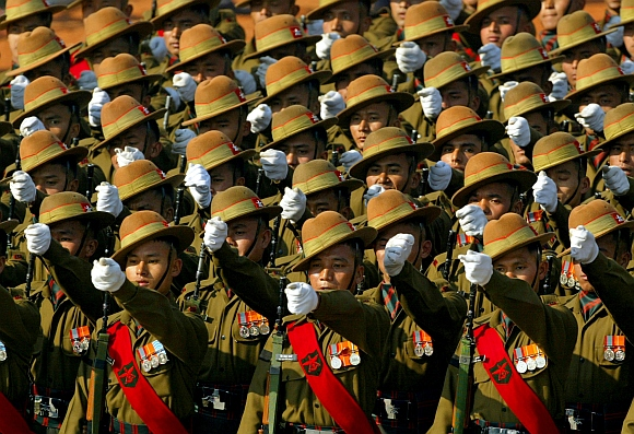 Soldiers from the Gurkha regiment take part in a full dress rehearsal for the Republic Day parade in New Delhi.