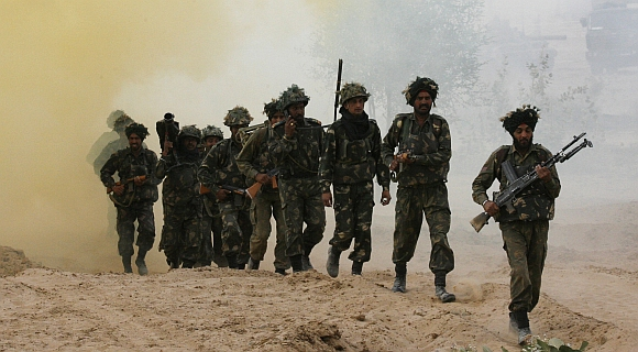 Infantrymen take part in an army exercise at Pallu in Rajasthan.