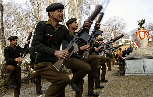 Troops of the 15 Corps hold weapons during Raising Day celebrations in Srinagar.