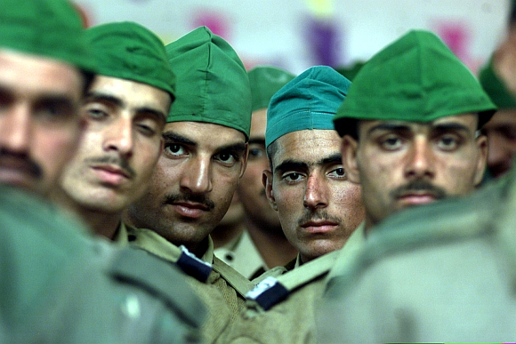 File picture shows recruits of Indian army's Jammu Kashmir Light Infantry Regiment listen to all religion prayers in a garrison in Rangreth, on the outskirts of Srinagar