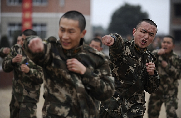People's Liberation Army troops attend a training session in Jiaxing, Zhejiang province