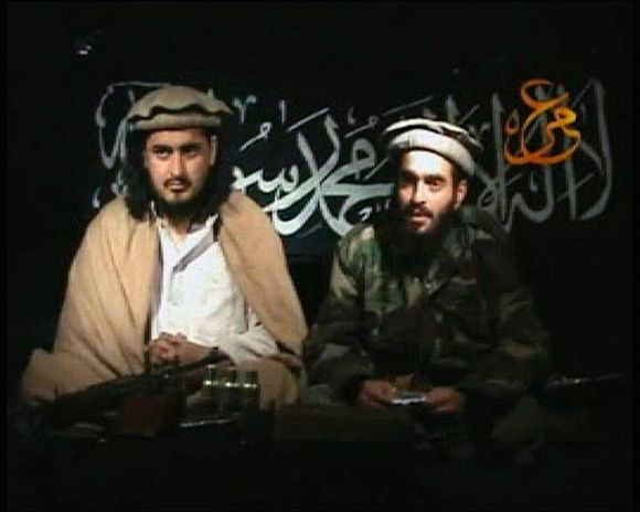 Video grab shows Hakimullah Mehsud, left, sitting beside a man who is believed to be Humam Khalil Abu-Mulal Al-Balawi, the suicide bomber who killed several CIA agents in Afghanistan