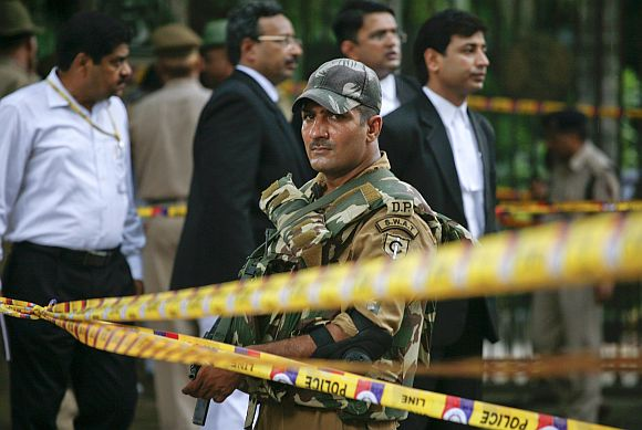 A Special Weapons And Tactics member from the Delhi police keeps vigil after cordoning off the site of a bomb blast outside the Delhi high court, in September, 2011