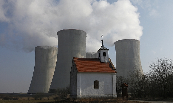 A chapel is seen in front of the cooling towers of the Czech nuclear power plant at Dukovany, 200 kilometers east from Prague