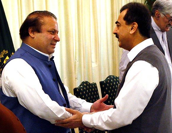 Pakistan's Prime Minister Yusuf Raza Gilani with former premier Nawaz Sharif