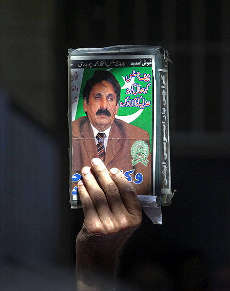 A lawyer holds an image of Chief Justice Iftikhar Chaudhry