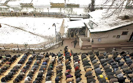 Muslims offer prayers on a snow-laden day in Srinagar