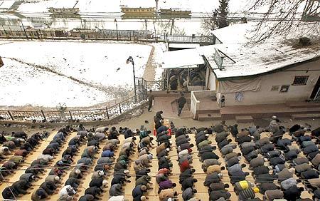 Muslims offer prayers on a snow-laden day in Srinagar