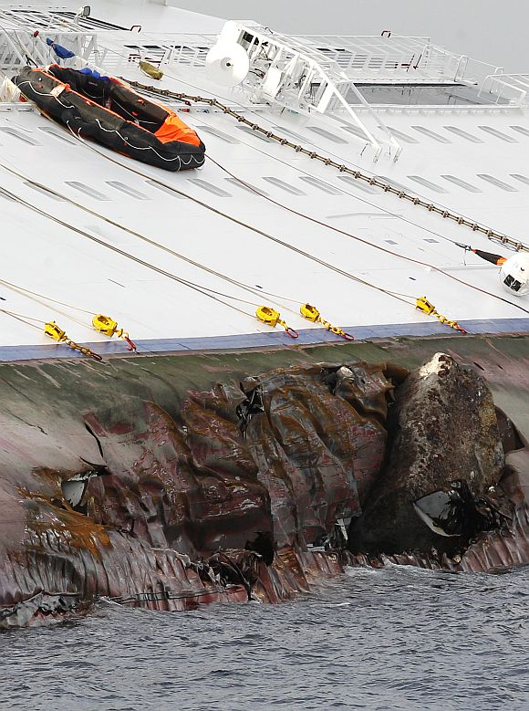 Holes are seen on Costa Concordia cruise ship that ran aground off the west coast of Italy
