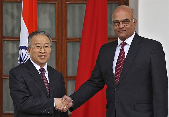 Dai Bingguo, China's state councillor, shakes hands with NSA Menon in New Delhi on Monday