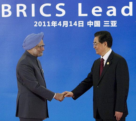 PM Singh is greeted by China's President Hu Jintao during the BRICS Leaders Meeting in Sanya, China in April, 2011