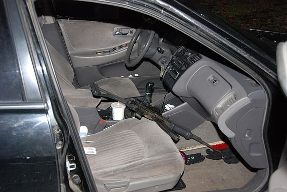 Handout photo of semi-automatic assault rifle inside an abandoned 1998 Honda Accord vehicle belonging to Oscar Ortega-Hernandez