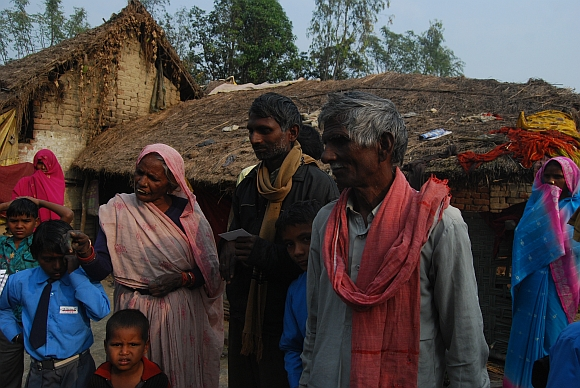 Suresh Kumar, centre, with his parents. He alleges his land was usurped by Yadavs from the neighbouring village