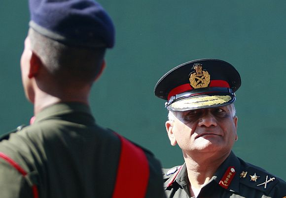 Army Chief General V K Singh inspects Sri Lankan soldiers during a military ceremony at the army headquarters in Colombo