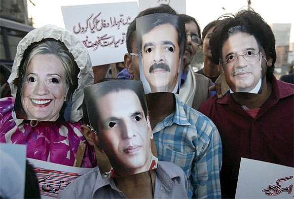 Protestors wearing masks of US Secretary of State Hillary Clinton, Pakistan army chief General Ashfaq Kayani, Prime Minister Yusuf Raza Gilani and President Asif Ali Zardari at a demonstration
