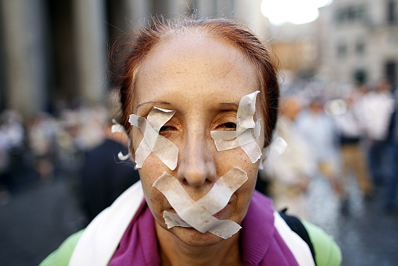 A woman taped her eyes and mouth to protest against a privacy law