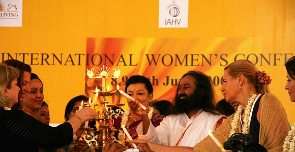 Art of Living Founder, Sri Sri Ravi Shankar lights the inaugural lamp along with prominent speakers during the 2009 conference