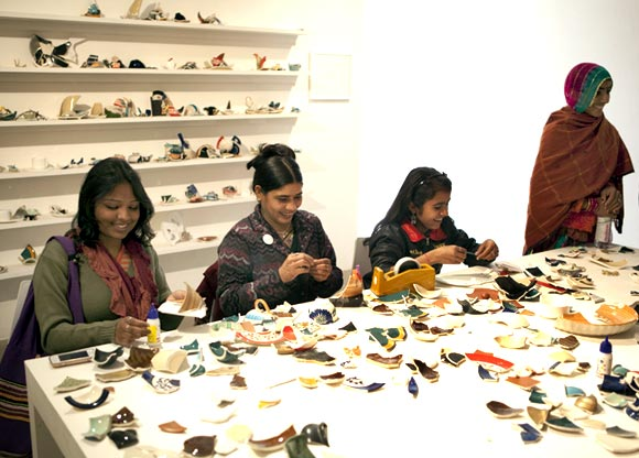 Visitors try their hand at Mend Piece
