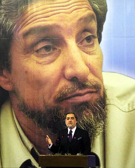 Abdullah Abdullah, now Afghanistan's chief executive, with a poster of his mentor, Ahmad Shah Massoud. Photograph: Fayaz Kabli/ Reuters