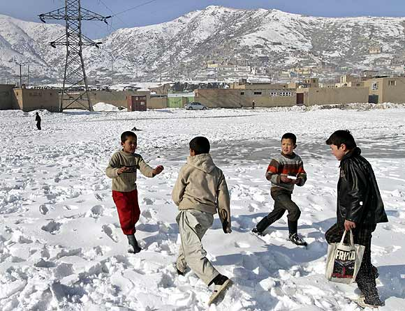 Afghan children play in the snow in an old part of Kabul.