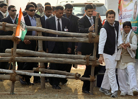 Rahul Gandhi walks ahead of the members of Special Protection Group during an election campaign rally at Gorakhpur