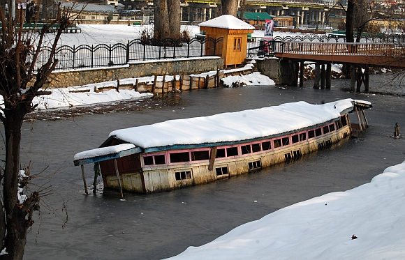 A houseboat submerged in the river Jhelum after a heavy snowfall