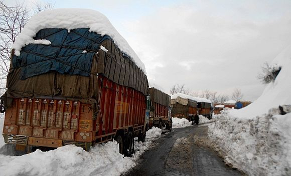 Stranded goods trucks near Jawahar Tunnel along Jammu Srinagar highway on Friday