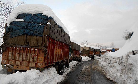Stranded goods trucks near Jawahar Tunnel along Jammu Srinagar highway on Friday