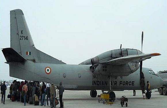 Stranded passengers board a special IAF flight, on Saturday
