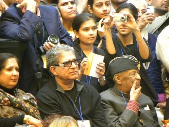 Spiritual guru Deepak Chopra listens to Winfrey intently
