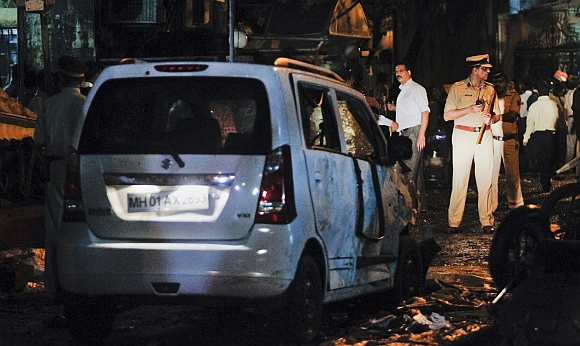 A policeman stands at the site of an explosion near the Opera House in Mumbai