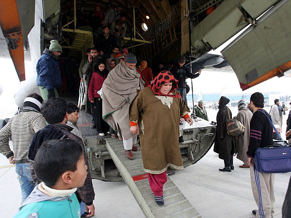 Rescued civilians disembark from the IAF's AN-32 relief aircraft
