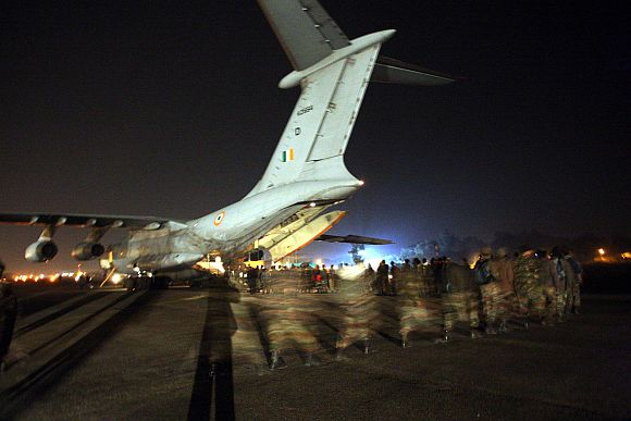 Army personnel boarding the IL-76 transpost aircraft