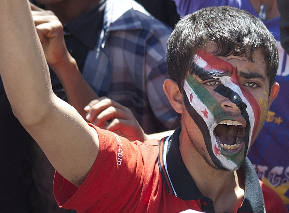 An anti-government protester shouts slogans during a rally in Sanaa