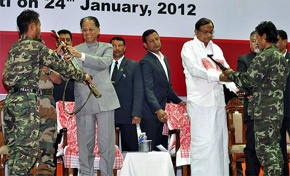 Representatives of Kuki Revolutionary Army outfit hand their arms to Union Home Minister P Chidambaram and  Chief Minister of Assam Tarun Gogoi at the arms laying down ceremony in Guwahati.