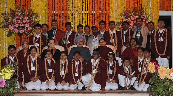 Prime Minister Manmohan Singh with the National Bravery Awards-2011 winners and their escorts, in New Delhi on January 23, 2012. National Advisory Council Chairperson Sonia Gandhi, Minister of State (Independent Charge) for Women and Child Development Krishna Tirath and Gursharan Kaur are also seen