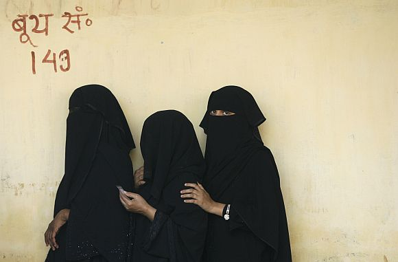 Muslim women wait to vote in Varanasi during the 2009 general election