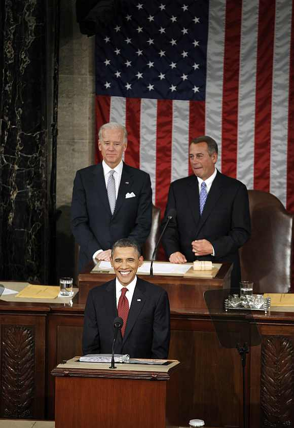 Obama delivers his State of the Union address to a joint session of Congress as Vice President Joe Biden and House Speaker John Boehner listen